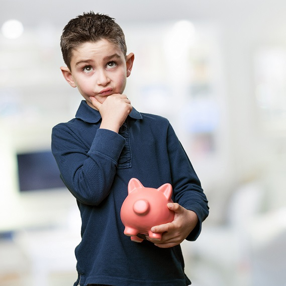little kid thinking with piggy bank